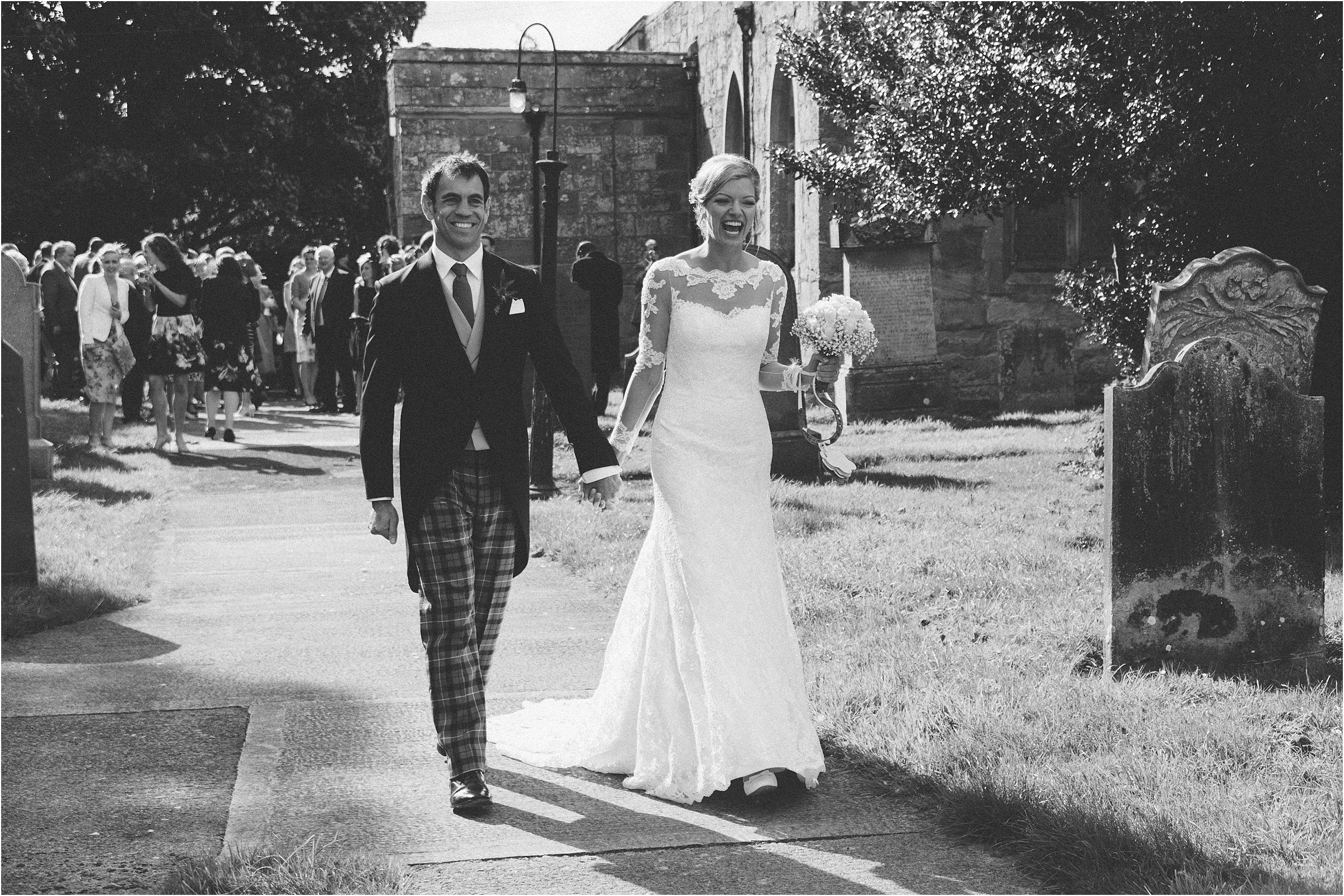 bride and groom leaving embleton church wedding northumberland